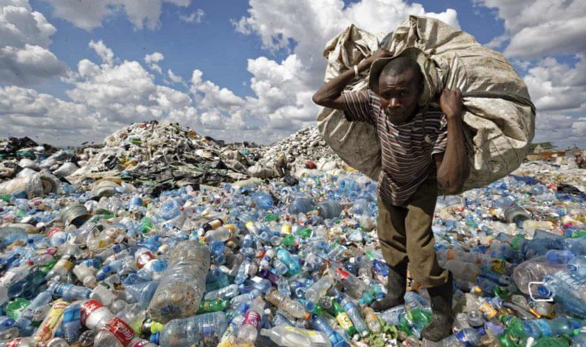 Recycler-in-Nairobi's-Dandora-District-walks-on-mountain-of-plastic-bottles-120518-by-@MckingtorchAfri, Earth Island Institute takes on Big Plastic, World News & Views