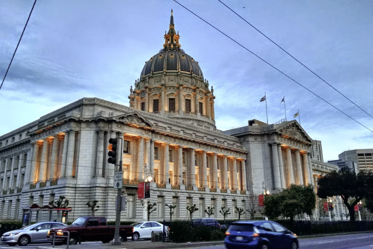 San-Francisco-City-Hall-by-Travis-Wise-Flickr, SF City Hall, use available funds to help wageless workers, unprotected hospital staff and the unhoused survive COVID-19, Local News & Views