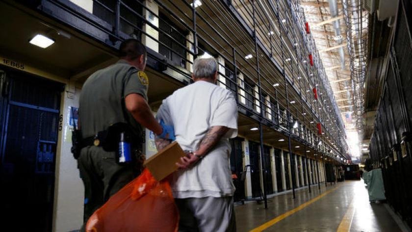 San-Quentin-death-row-prisoner-escorted-by-guard-081616-by-Gary-Coronado-LA-Times, Coronavirus: The invisible enemy behind enemy lines, Behind Enemy Lines