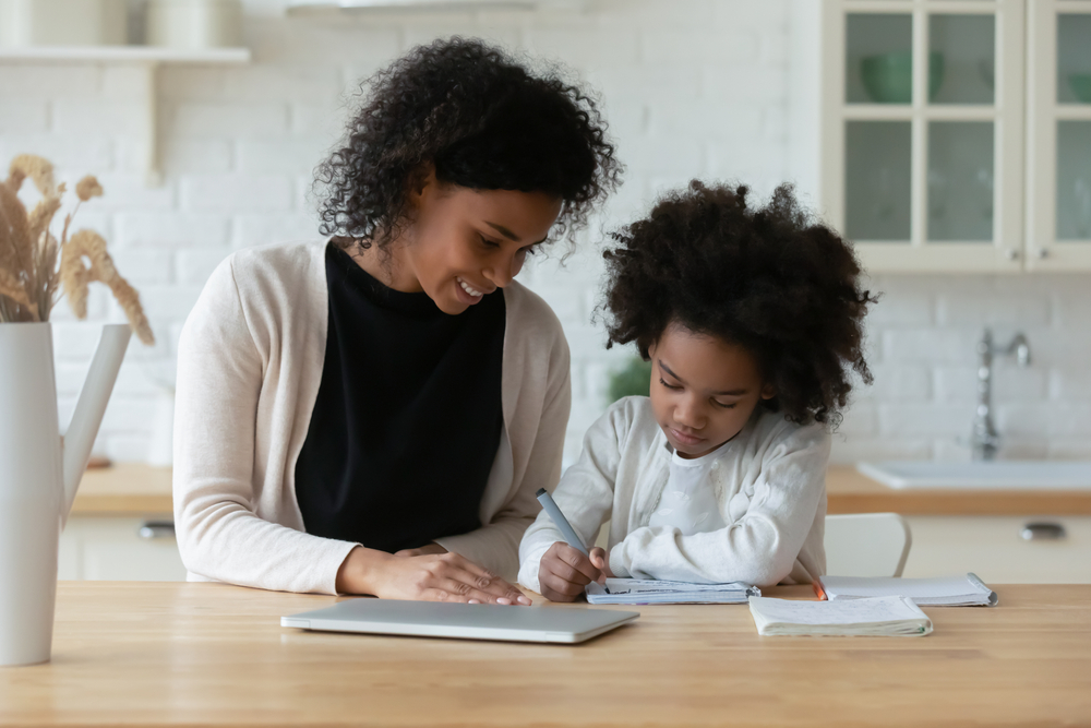 Black-mother-helps-daughter-with-school-work-in-kitchen, Getting ahead of the curve: Resources for parents who are laid off or struggling during the COVID-19 Crisis, Culture Currents