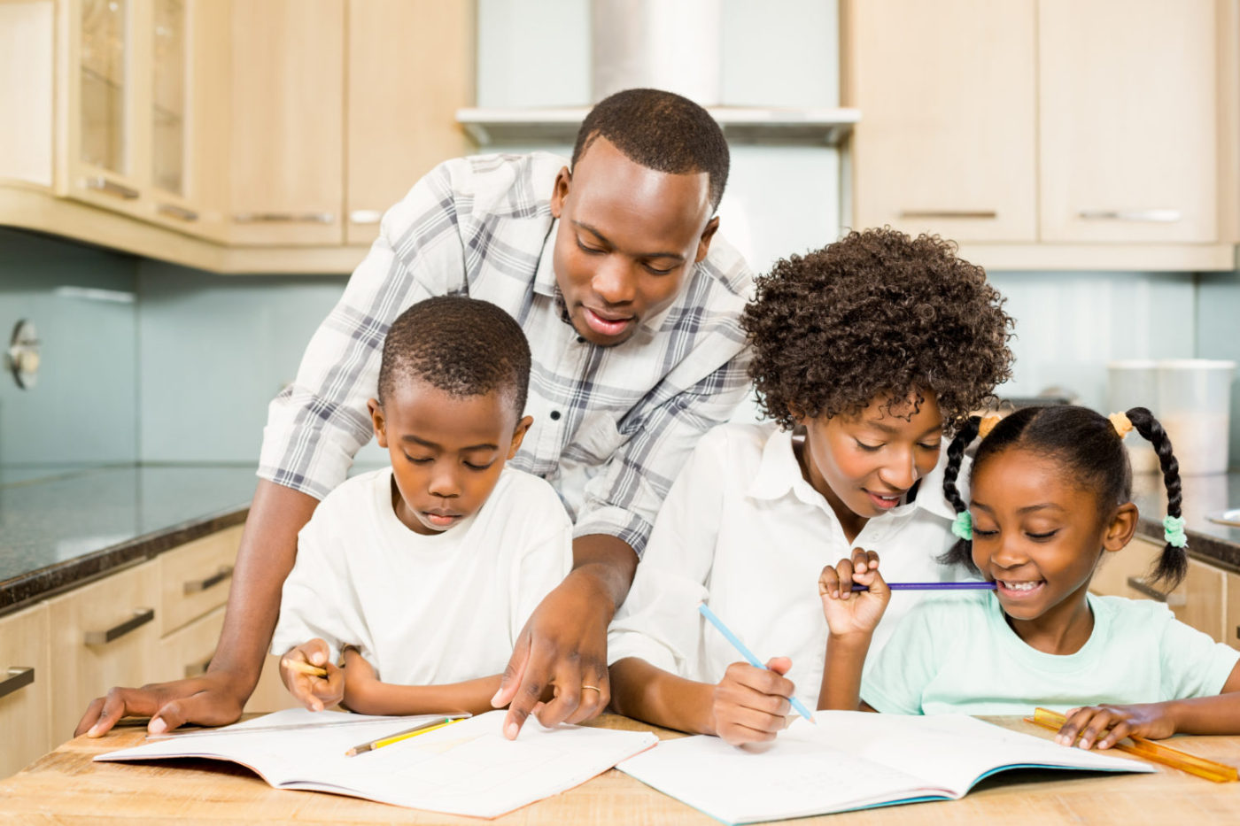 Black-parents-helping-children-with-homework-in-kitchen-1-1400x933, Getting ahead of the curve: Resources for parents who are laid off or struggling during the COVID-19 Crisis, Culture Currents