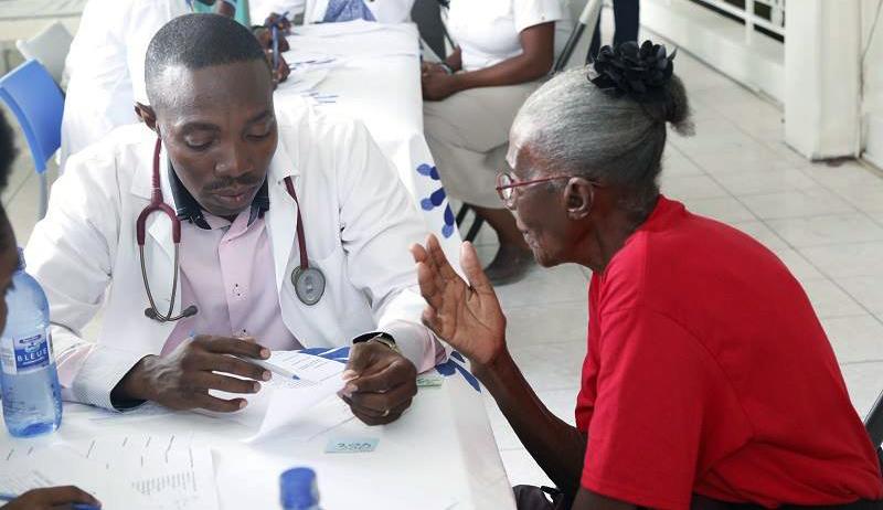 Haitian-doctor-patient-during-coronavirus-pandemic, Resisting COVID-19 in Haiti, World News & Views