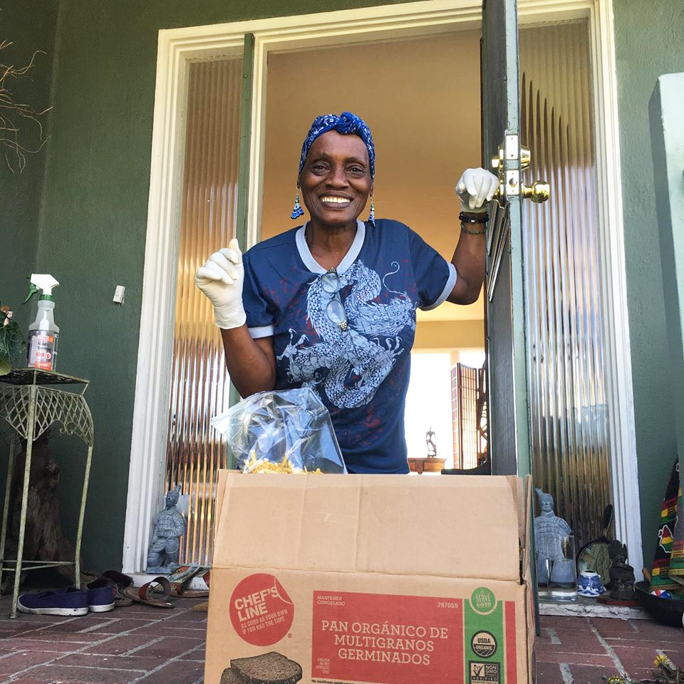 Happy-elder-receives-food-box-from-East-Oakland-Collective, COVID-19 further burdens Oakland's Black homeless population's quest to survive, Local News & Views