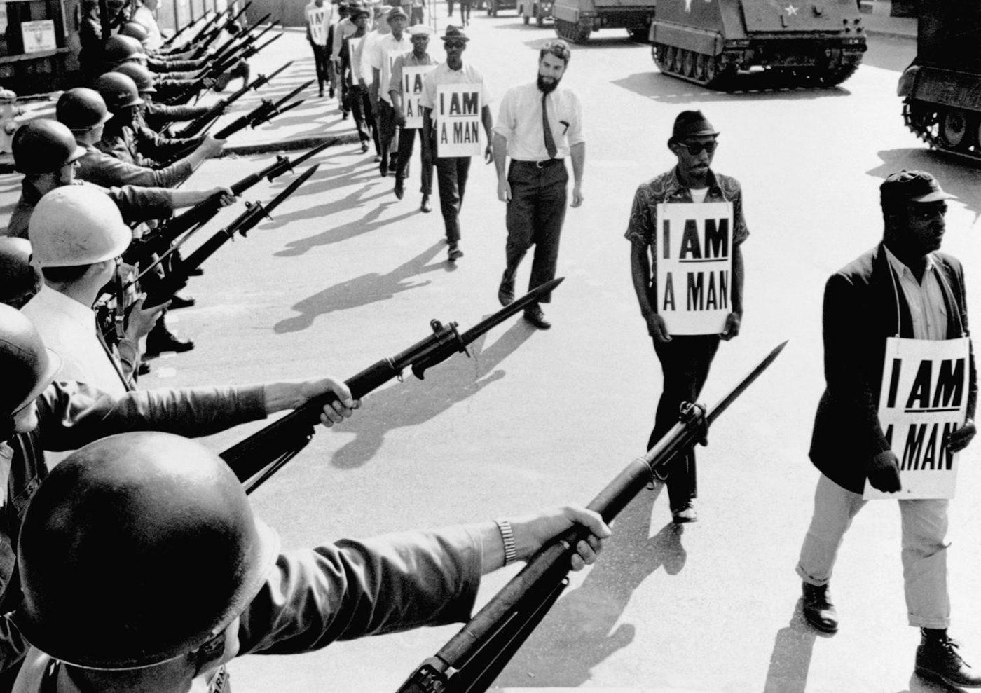 I-am-a-man-guns-tanks-Memphis-0368-by-Bettmann-CORBIS-1400x989, New Orleans sanitation 'hoppers' form union, strike for hazard pay, PPE, benefits, National News & Views