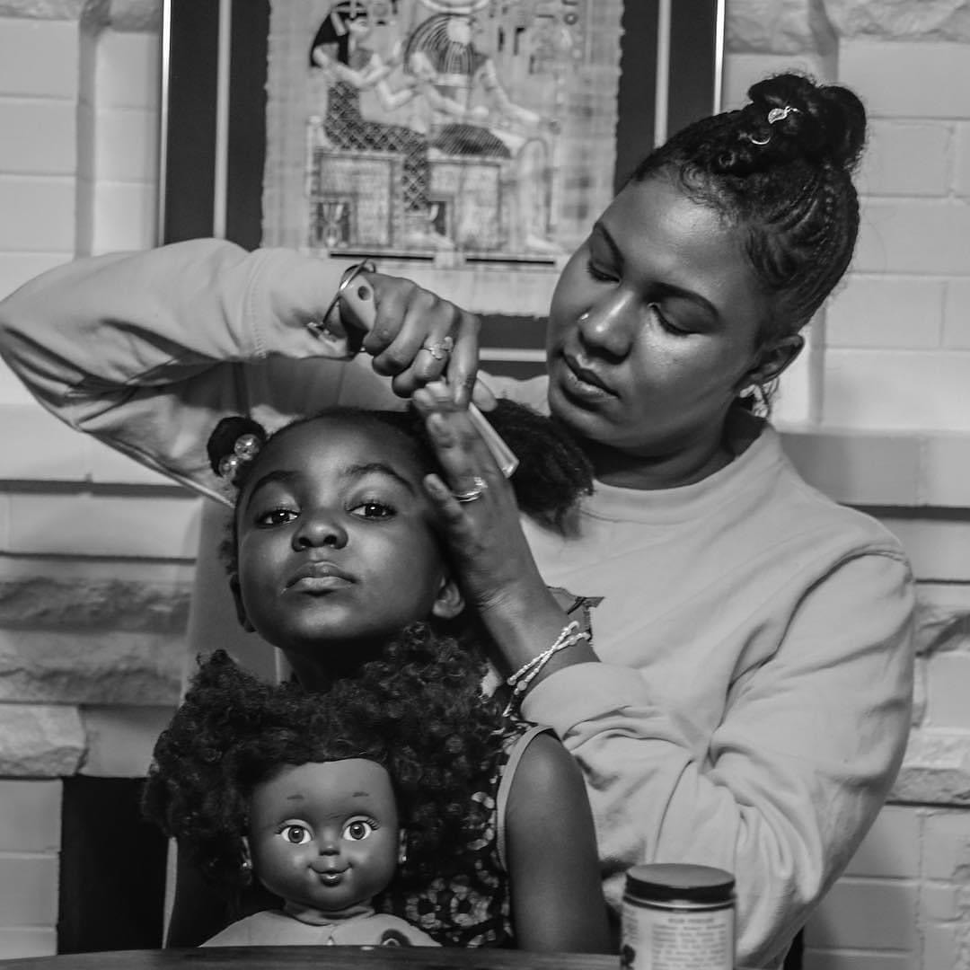 Tanafer-Camara-of-TLC-Consulting-and-Maternal-Healing-does-her-daughters-hair-by-Brittsense, Birthing Black babies during a pandemic, Local News & Views