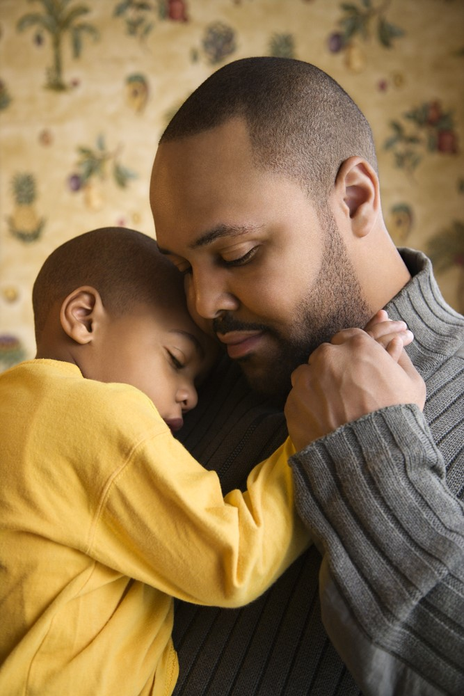 Father-comforts-lil-boy-both-Black-1, Coronavirus parenting: Protecting your children during the pandemic, Culture Currents