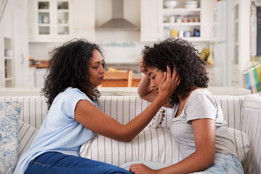 Mother-comforts-teenage-daughter-both-Black, Coronavirus parenting: Protecting your children during the pandemic, Culture Currents