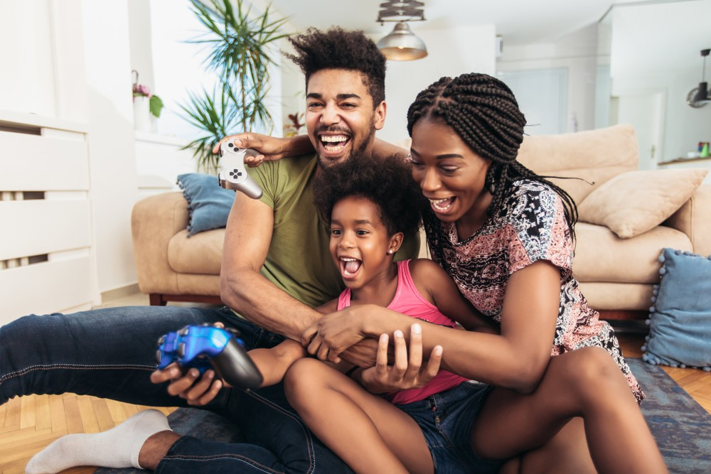 Young-Black-family-playing-video-games, Coronavirus parenting: Protecting your children during the pandemic, Culture Currents
