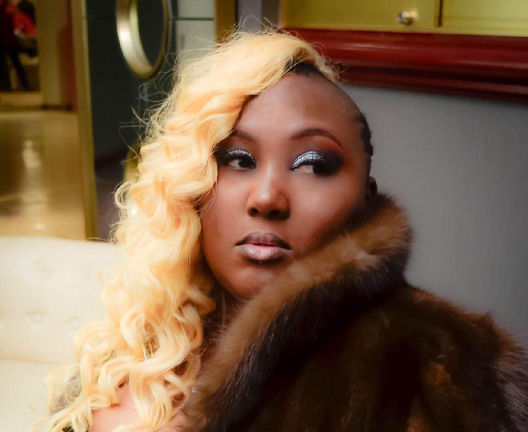 Tia-Hamilton-fur-coat-cropped, Meet Tia 'Mz Konnoisseur' Hamilton of State vs. Us Magazine, Culture Currents