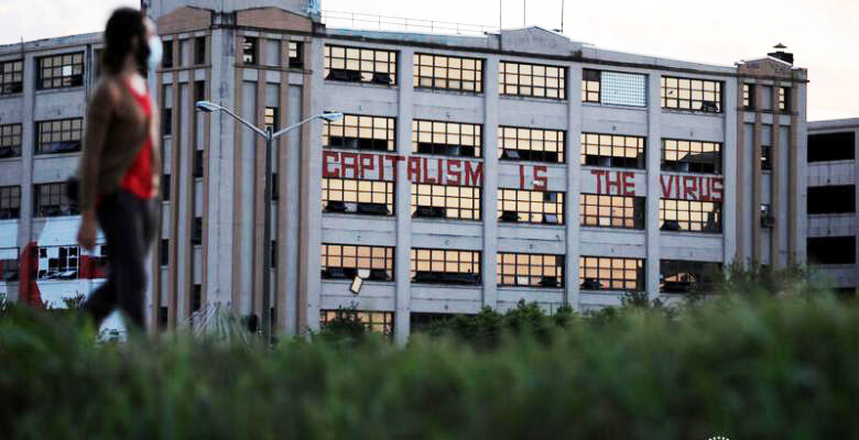 Capitalism-is-the-virus-painted-on-abandoned-factory-in-New-Orleans-by-Carlos-Barria-Reuters, Jalil Muntaqim: Future focused in Black August 2020, Behind Enemy Lines