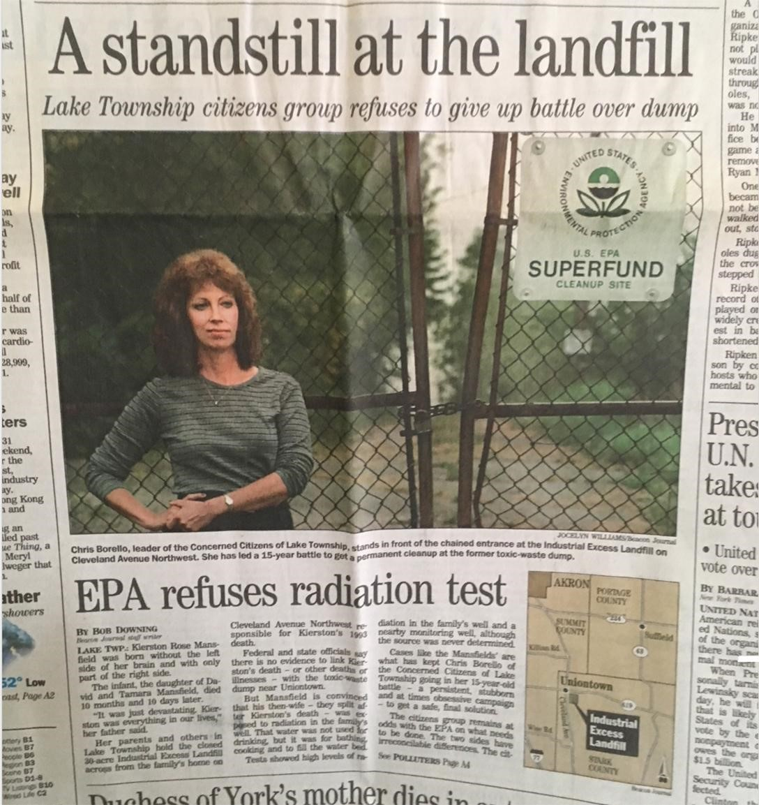 Chris-Borello-co-founder-of-Concerned-Citizens-of-Lake-Township-stands-at-Industrial-Excess-Landfill-chained-gate, 2020 hindsight brings corrupted radiation testing into focus at the EPA – Part 1, National News & Views