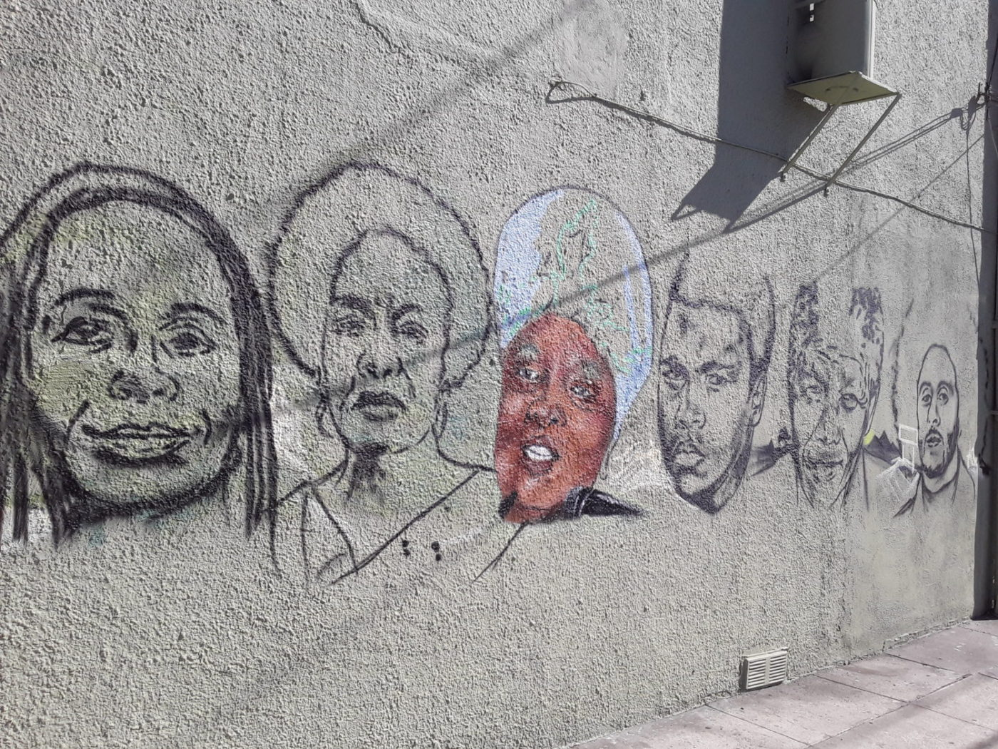 Black muralist Kufu attacks the walls of East Oakland to show us our fighting heart and soul