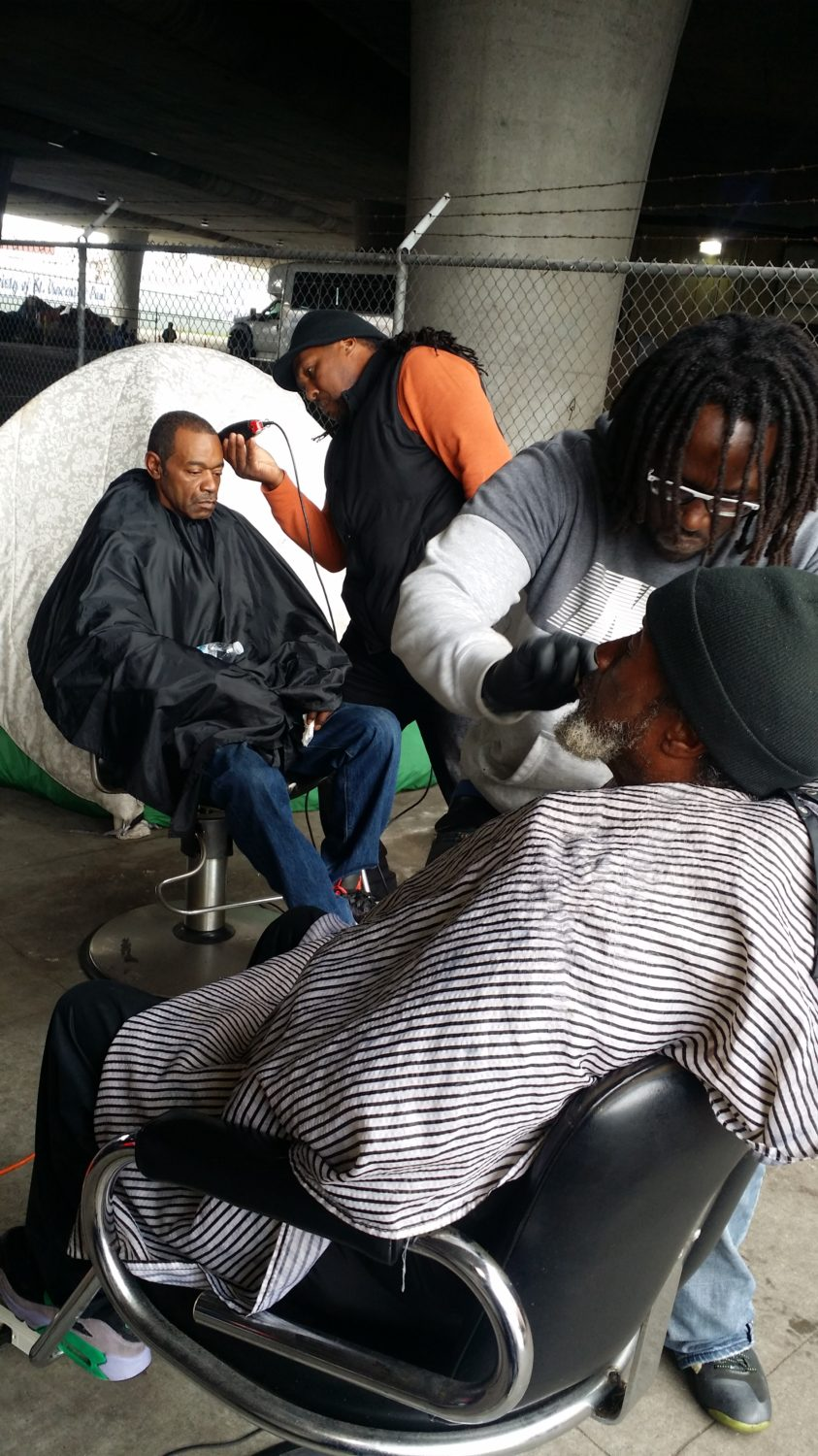 Struggle-to-Bubble-barbering-at-homeless-encampment, Struggle to Bubble is still empowering homeless people amid the pandemic in Oakland, Local News & Views