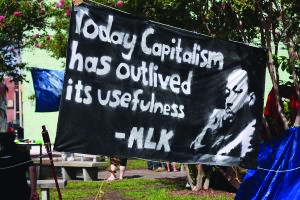 Today-capitalism-has-outlived-its-usefulness-banner-homeless-encampment, Jalil Muntaqim: Future focused in Black August 2020, Behind Enemy Lines