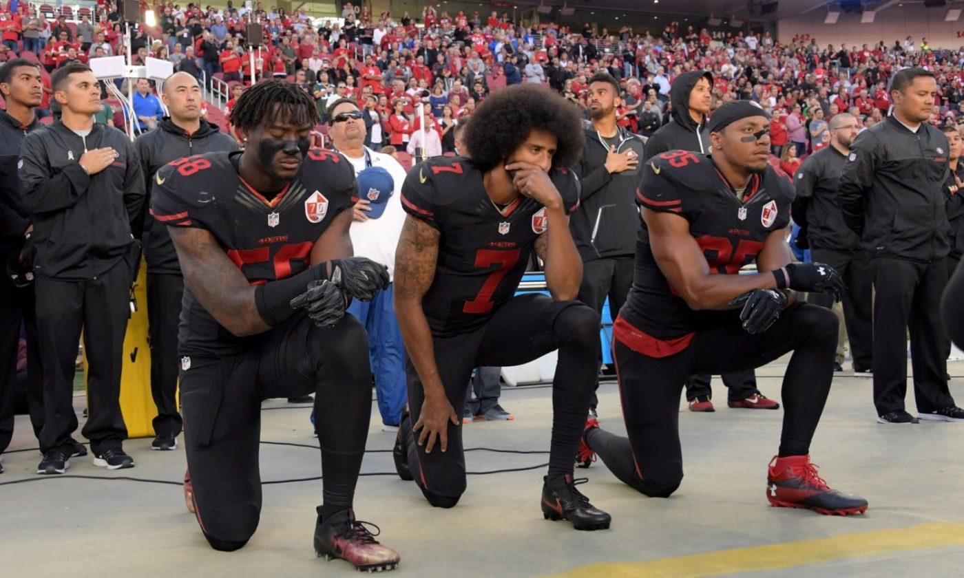 Colin-Kaepernick-Eli-Harold-Eric-Reid-take-a-knee-100616-by-USA-Today-Sports-1400x840, Disentangling US team sports and US militarism, National News & Views