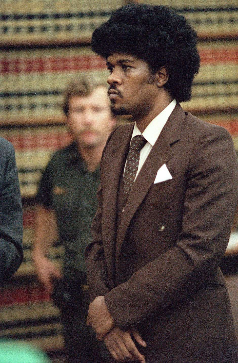 Kevin-Cooper-stands-before-San-Diego-judge-at-death-penalty-trial-1985-by-Dave-Siccardi-AP, Kevin Cooper: Surviving Death Row and COVID-19 in San Quentin, Behind Enemy Lines
