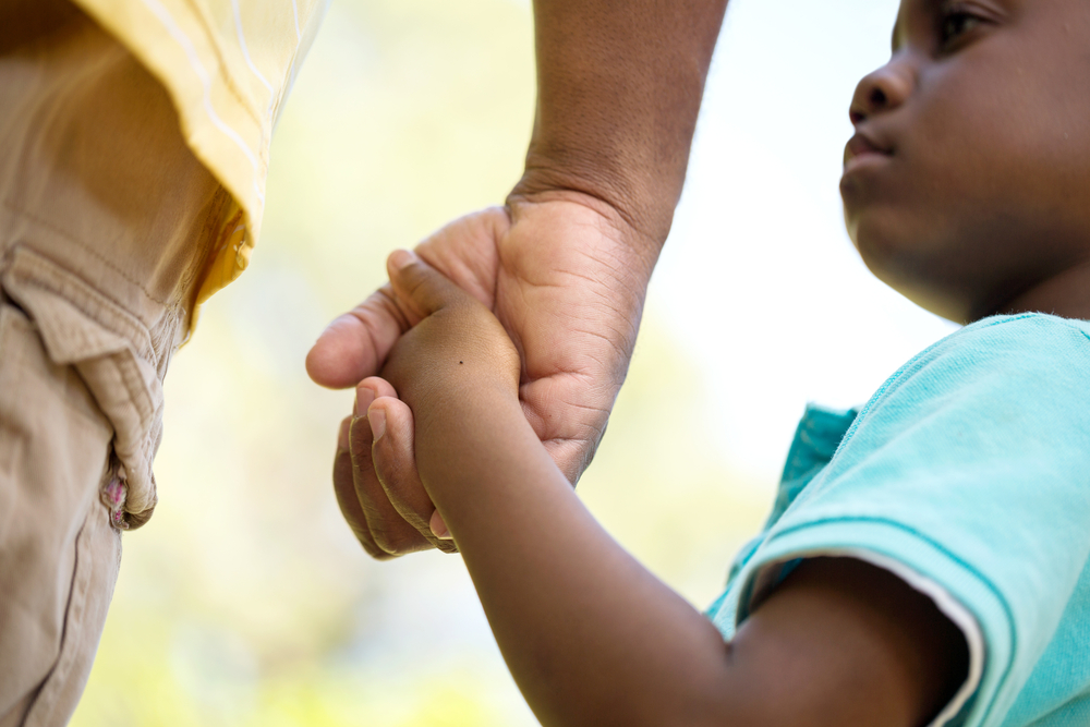 Lil-Black-child-holds-adult-hand, Having 'The Talk' with your children in the era of Black Lives Matter, Culture Currents