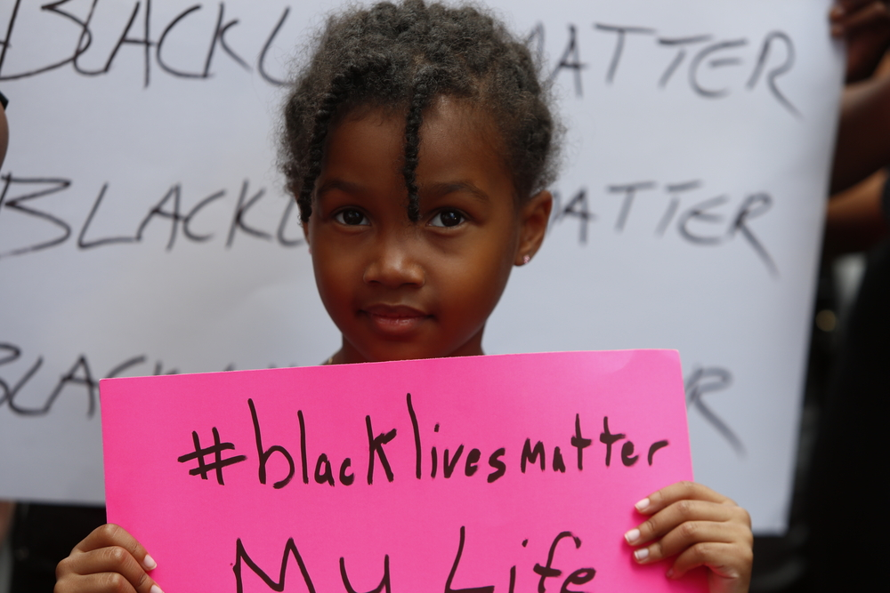 Lil-Black-girl-w-Black-Lives-Matter-sign, Having 'The Talk' with your children in the era of Black Lives Matter, Culture Currents