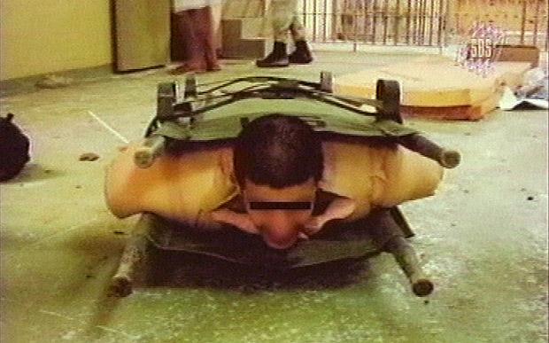 Prisoner-tortured-in-stress-position-Abu-Ghraib-Baghdad-by-AP, Military torture in Indiana prisons, Behind Enemy Lines