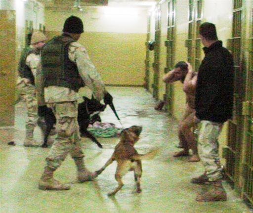US-soldiers-dog-terrorize-prisoner-Abu-Ghraib-2003-2, Military torture in Indiana prisons, Behind Enemy Lines