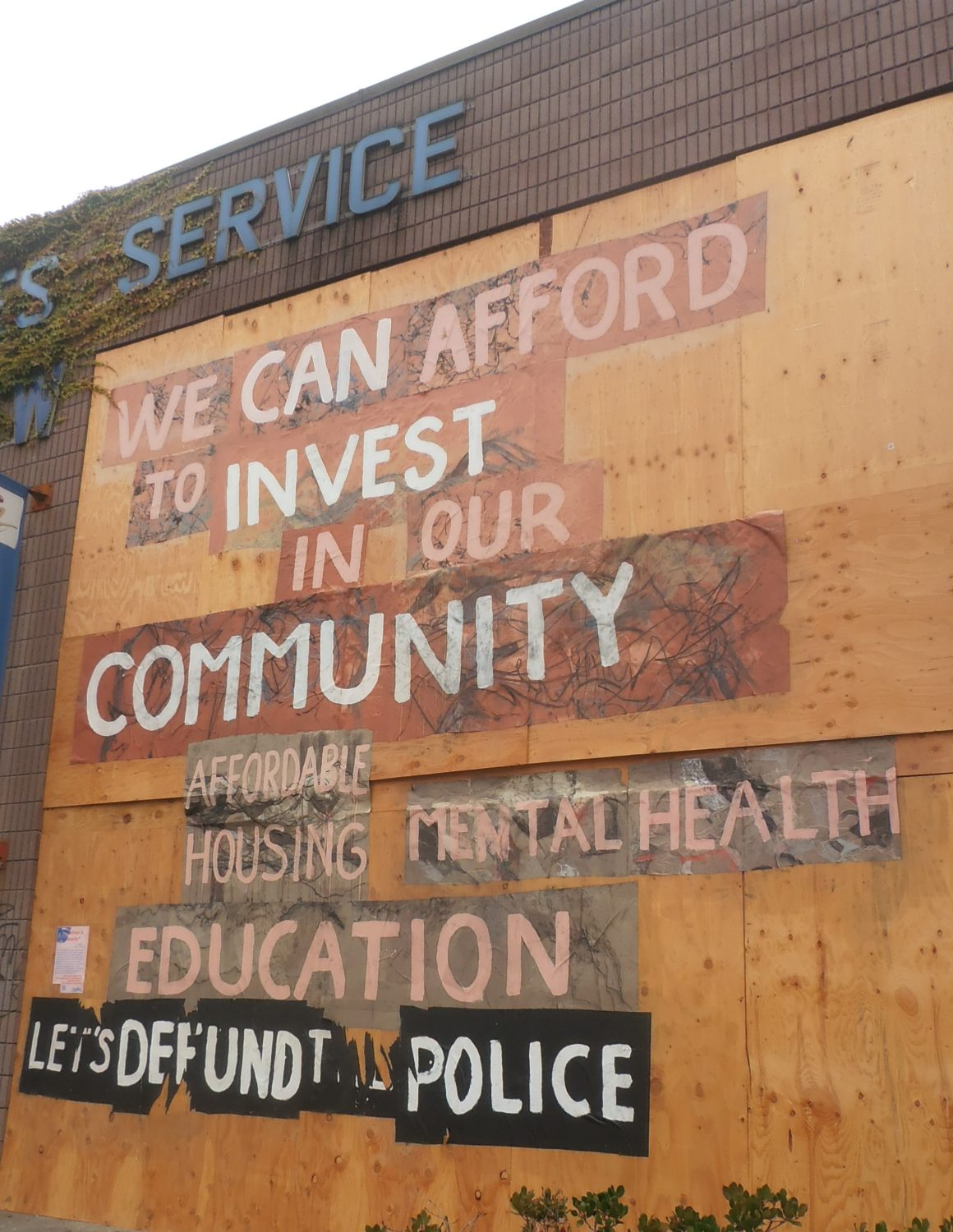 We-can-afford-to-invest-in-our-community-...-defund-the-police-message-on-boarded-up-window-Oakland-0820-by-Jahahara, Register, vote (y)our interests and continue organizing for power!, Culture Currents
