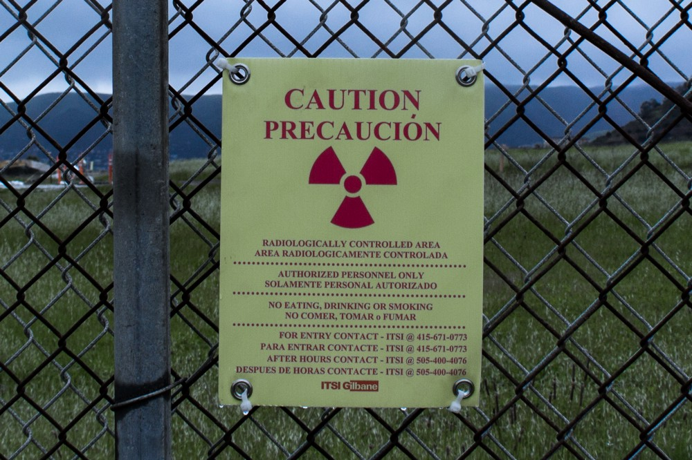 Caution-signs-mark-radiologically-controlled-areas-throughout-the-shipyard-2016-by-Devon-Kelley, 2020 hindsight on dirty deeds done dirt cheap at Hunters Point, Local News & Views