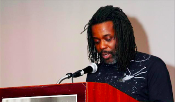 Russell-Shoatz-III-son-of-Maroon-speaks-at-Malcolm-X-Commem.Cmtes-18th-annual-dinner-for-PPs-families-cropped-2, A son's fight for his father's freedom, Behind Enemy Lines