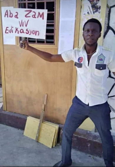 Gregory-Saint-Hilaire-holds-sign-'Down-with-Weapons-ie-police-G9-type-paramilitaries-Long-Live-Education-Haiti-2020, Stop the massacres in Haiti: End US and UN support for the criminal regime of Jovenel Moise, World News & Views