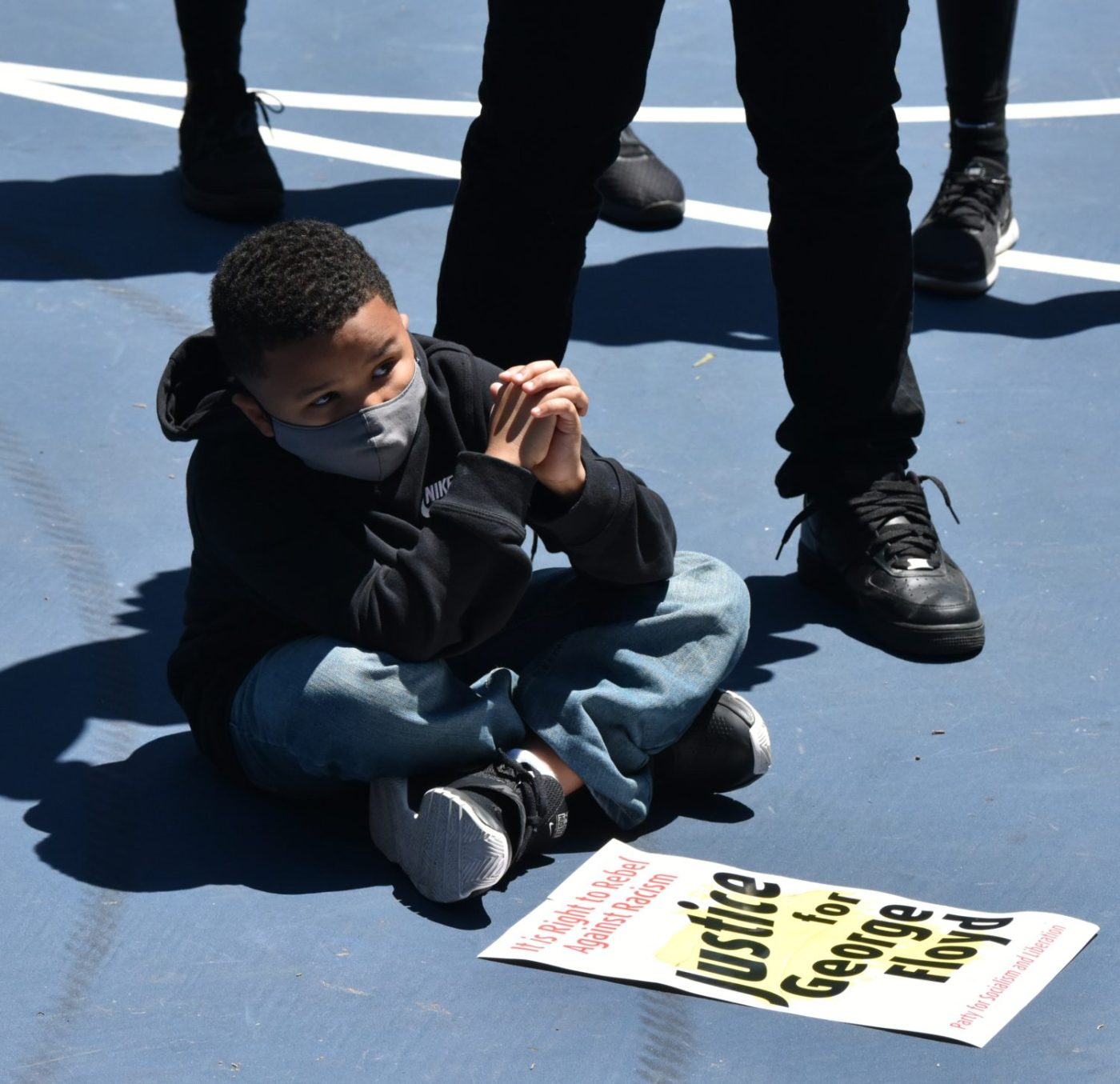 Lil-Black-boy-sits-on-pavement-at-rally-w-Justice-for-George-Floyd-sign-2020-by-Johnnie-Burrell-1400x1355, Advocacy without results is dead, National News & Views