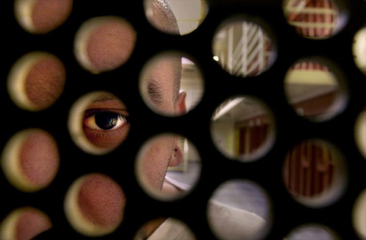Pelican-Bay-SHU-eye-through-cell-door, View from Treblinka Dungeon Pelican Bay, Behind Enemy Lines