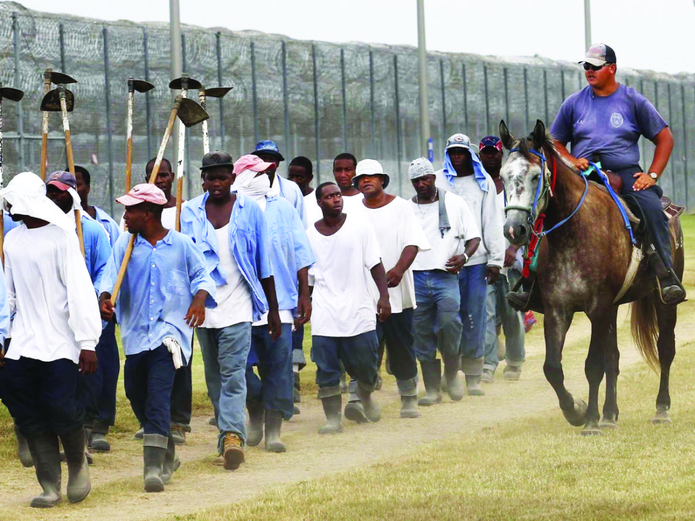 Angola-prisoners-marched-to-farm-work-1400x1050, Louisiana: The last slave state in America, Behind Enemy Lines