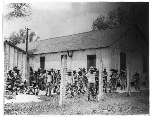 Angola_Prison_1934-_Leadbelly_in_the_foreground, Louisiana: The last slave state in America, Behind Enemy Lines