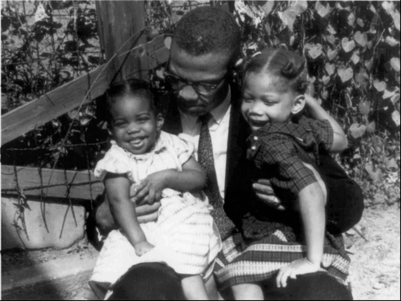 Malcolm-with-daughters-Qubilah-Atallah-by-CBS-News-1400x1053, Former cop's deathbed confession reveals his role in assassinating Malcolm X, National News & Views