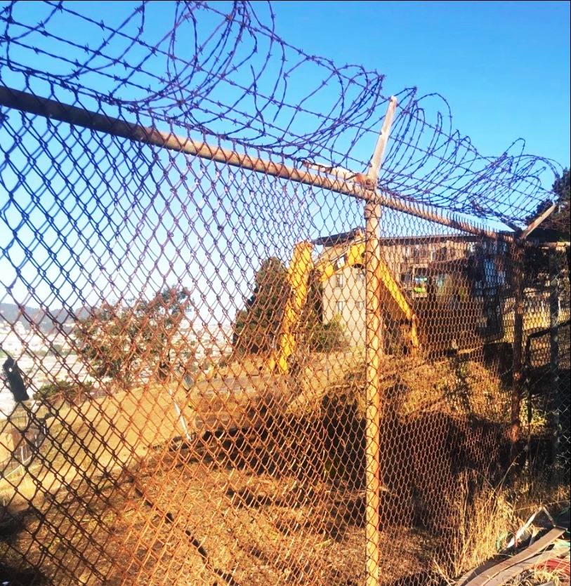 Backhoe-excavates-at-fenceline-betw-Hunters-Point-Shipyard-densely-populated-HP-hilltop-c.-0920-by-residents, Brain cancer biomonitoring in Bayview Hunters Point, Local News & Views