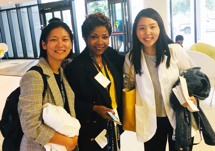 Dr.-Ramona-Tascoe-w-students-School-of-Medicine-Class-of-2023-White-Coat-Ceremony, Never cease to explore!, Local News & Views