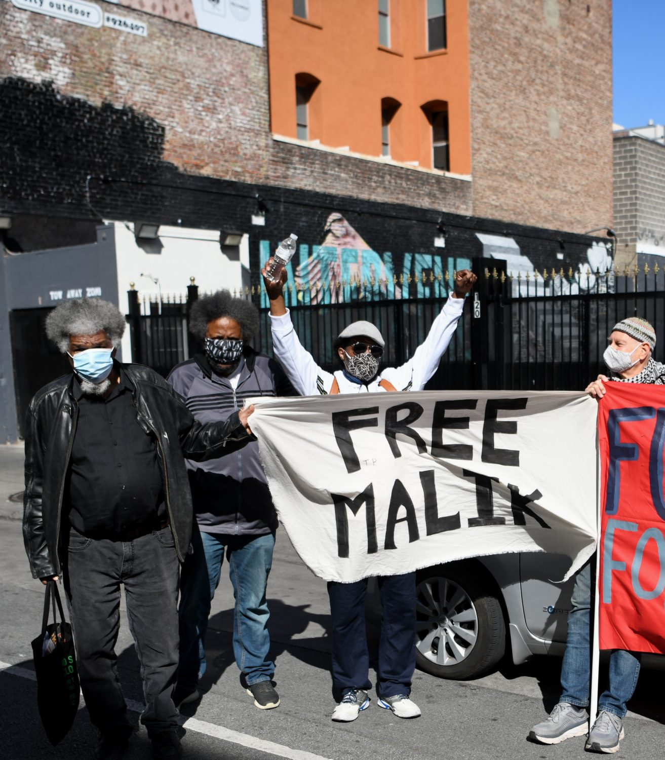 Free-Malik-rally-111-Taylor-Gerald-Smith-Arthur-League-unk-Charlie-Hinton-030721-by-Johnnie-Burrell, Journalist detained at GEO Group halfway house faces retaliation for exposing COVID-19 outbreak, Local News & Views