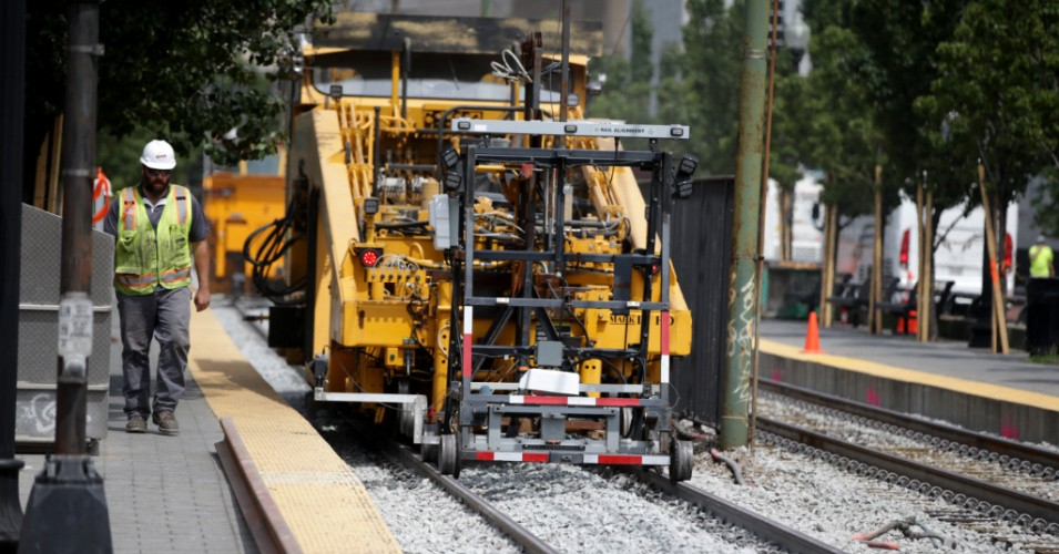 Workers-upgrade-Green-Line-light-rail-Boston-080620-by-Jonathan-Wiggs-Boston-Globe, Democrats unveil 'Build Green' Infrastructure and Jobs Act, National News & Views