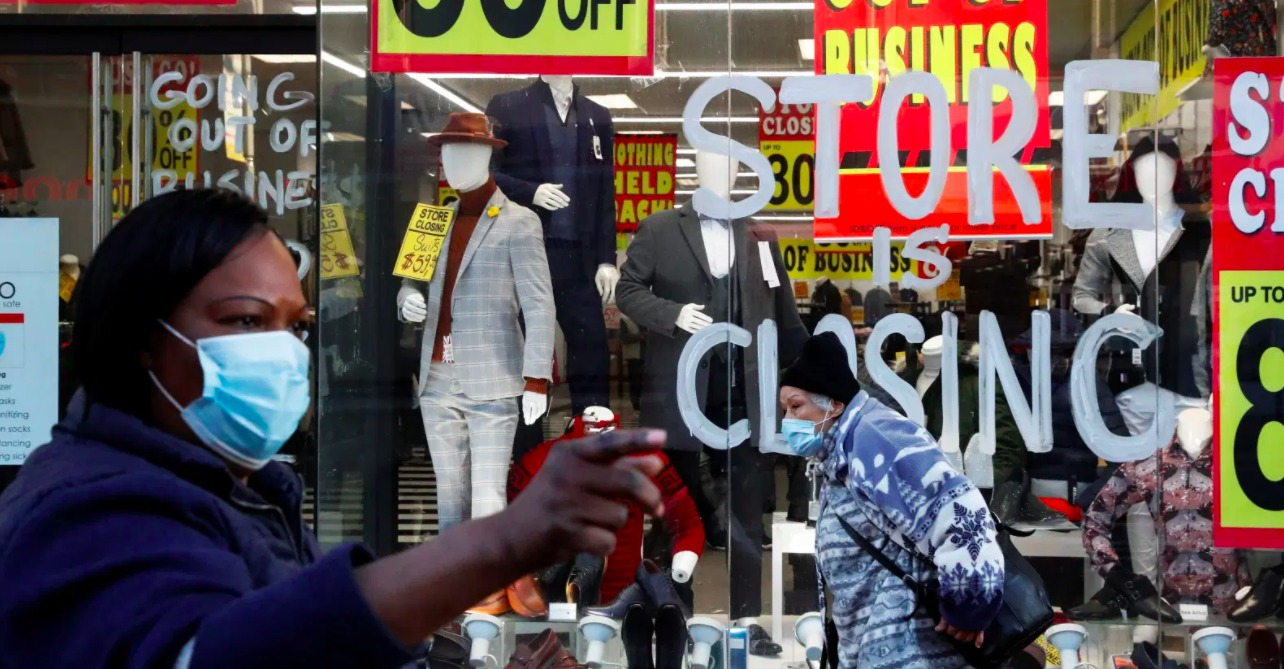 Store-is-closing-window-sign-Black-woman-pointing-by-Quartz, Broadened tech access for Blacks and Hispanics slowed by FCC, Local News & Views