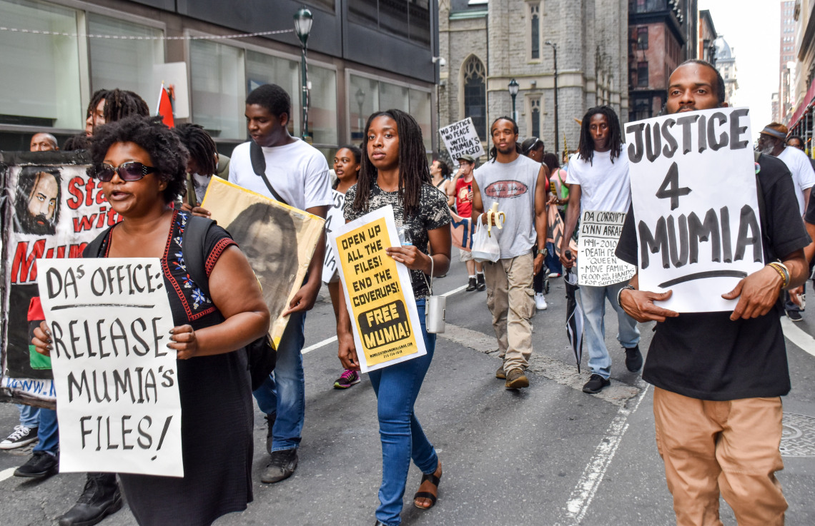 All-Black-march-for-Mumia-Philly-070717-by-Joe-Piette, Mumia Abu-Jamal is scheduled for open-heart surgery, Behind Enemy Lines