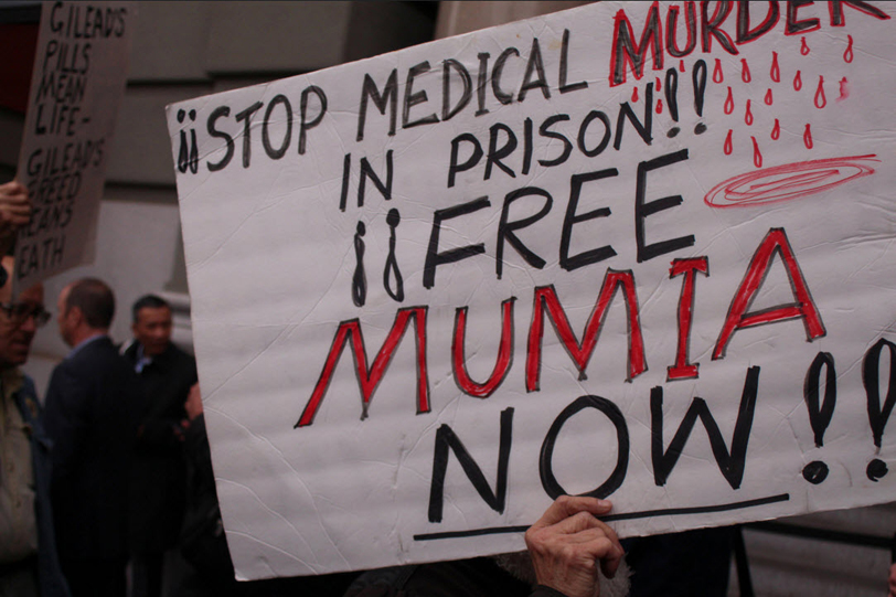 Big-Pharma-protest-Stop-medical-murder-Free-Mumia-JP-Morgan-conf-St.-Francis-Hotel-011216-by-Anka-Karewicz, Mumia Abu-Jamal is scheduled for open-heart surgery, Behind Enemy Lines