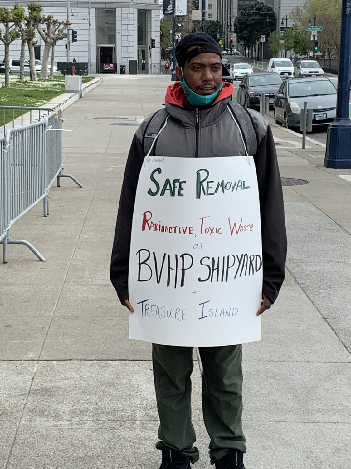 Dominique-wears-sign-'Safe-removal-radioactive-toxic-waste-BVHP-Shipyard-Treasure-Island-Earth-Day-Rally-City-Hall-042221, Earth Day 2021 in San Francisco!, Local News & Views