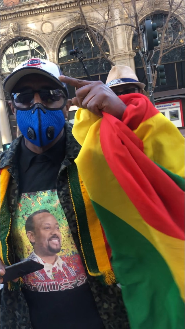 Eritrea-Ethiopia-rally-by-Dina-Tesfay-man-with-Isaias-shirt-032621, End the war on Africans: The truth about Eritrea and Ethiopia's brutal regimes, World News & Views
