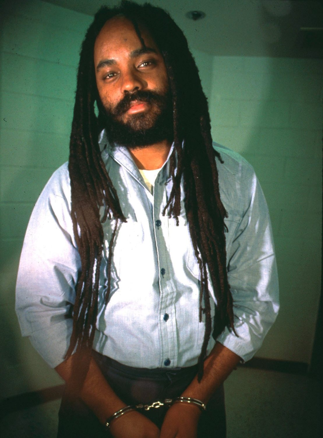 Mumia-Abu-Jamal-121395-by-Lisa-Terry-Liaison-Agency, Mumia Abu-Jamal is scheduled for open-heart surgery, Behind Enemy Lines