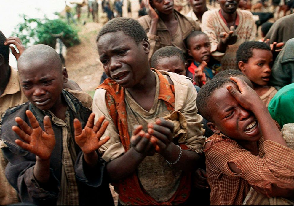 Rwandan-children-fleeing-Rwanda-plead-with-Zairean-soldiers-to-let-them-cross-a-bridge-to-join-their-mothers-082094-by-Jean-marc-Bouju-AP, Rwanda and Zaire (DRC) 1990 to 1997, where the US blocked real humanitarian intervention, World News & Views