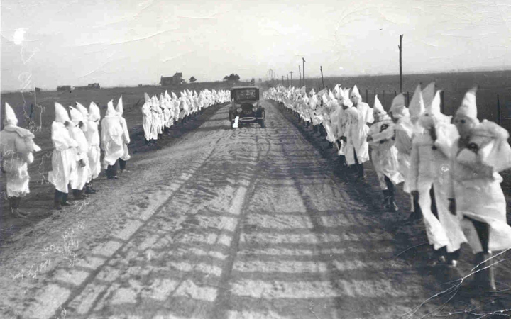 Ku-Klux-Klan-grew-in-Okla-after-Tulsa-Race-Riot-Black-Wall-Street-Drumright-Okla-1922-by-Tulsa-Historical-Society, Rep. Barbara Lee marks 100th anniversary of Tulsa Greenwood Massacre, calling for reparations and a truth, racial healing and transformation commission, National News & Views