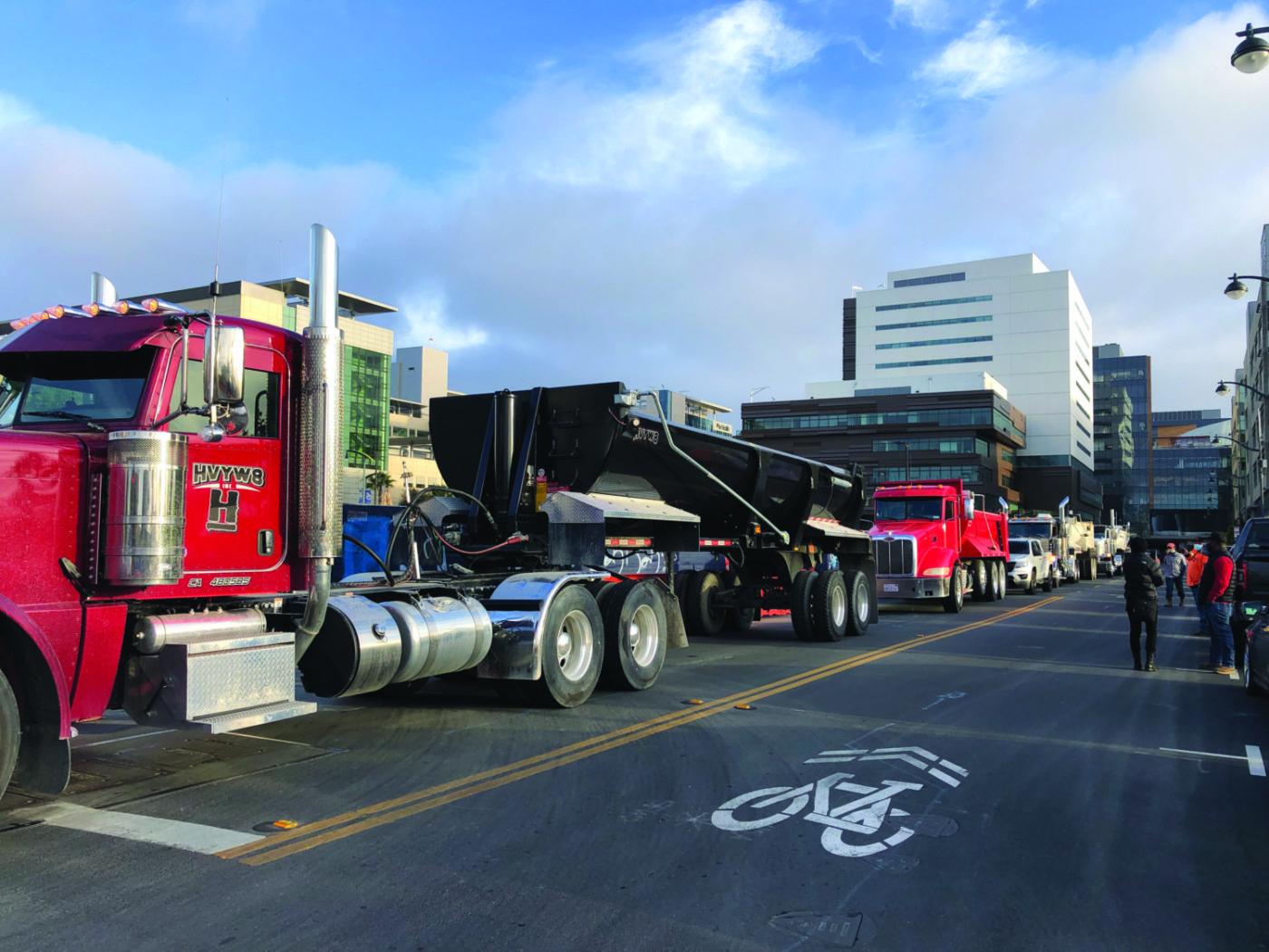 Line-of-Black-dirt-hauling-trucks-blocking-entrance-UCSF-job-site-shutdown-043021-by-Griffin-1400x1050, Black truckers shut down multi-million-dollar UCSF job site for 4.5 hours, Local News & Views