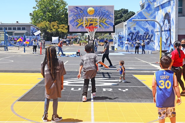 Children-play-as-Eat.-Learn.-Play-dedicates-new-Franklin-Elementary-playground-court-garden-project-061221-by-Kelly-Sullivan-Getty-Images, The Curry family helps renovate and unveil new playground at East Oakland elementary school, Local News & Views
