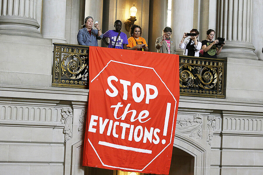 Stop-the-evictions-banner-unfurled-on-balcony-inside-City-Hall-2015-by-Eric-Risberg-AP-1, Daybreak PAC teams up with Open Door Legal to prevent 'Tsunami of Evictions', Local News & Views