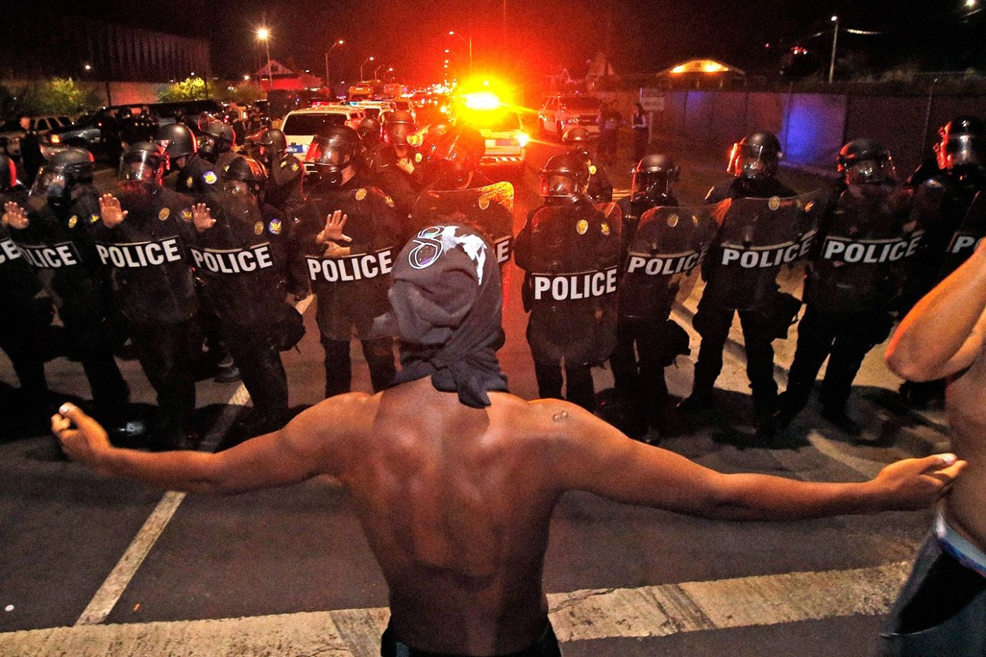 Black-man-with-arms-outstretched-faces-line-of-riot-police-2016-by-Ross-D.-Franklin-AP-1400x933, San Francisco is NOT a law enforcement reform leader, Local News & Views