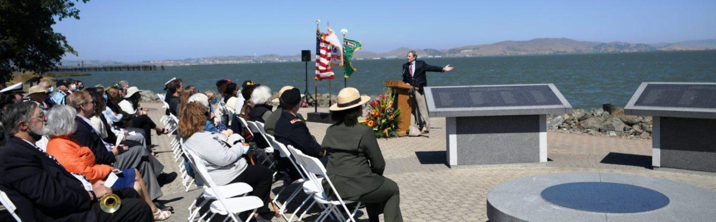 Congressman-Mark-DeSaulnier-at-podium-77th-anniversary-commemoration-of-the-Port-Chicago-Explosion-by-Johnnie-Burrell-071721-1400x434, 77th anniversary commemoration of the Port Chicago Explosion, Local News & Views